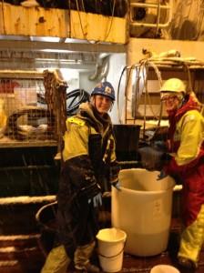 Svetlana Murzina and Svetlana Pekkoeva pick up Leptoclinus from the bottom trawl